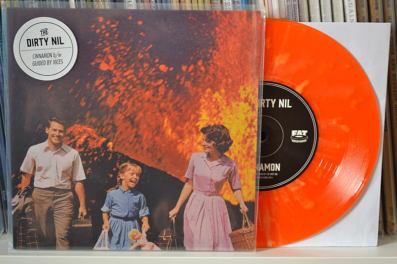 The Dirty Nil: Translucent orange w/ yellow splatter