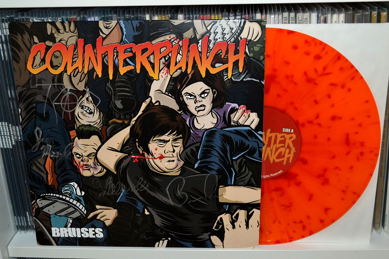 Counterpunch: Bruises - Translucent orange w/ red splatter vinyl